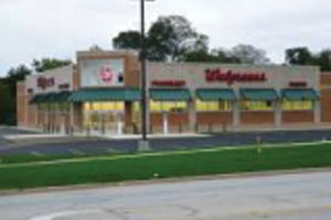 walgreens pharmacy building with metal roof panels